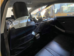 Glass guard between drivers and passengers inside a Black Top taxi