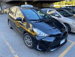 A Black Top & Checker Cabs taxi